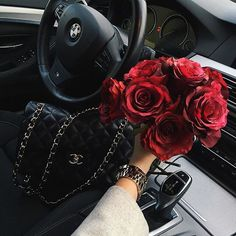 Everything that a girl needs. BMW, Chanel purse, and a bouquet of red roses