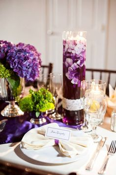 Floating candle centerpiece - photo by Candice Benjamin