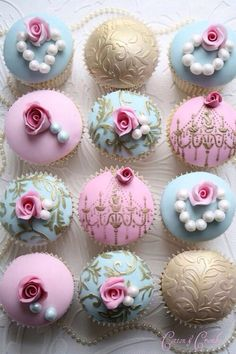 Pink, teal and gold fondant cupcakes with flowers.