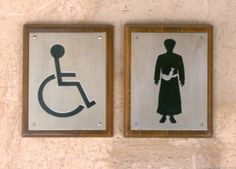 Offbeat Images -- Middle eastern man wearing dishdasha toilet sign, Nizwa Fort, Nizwa, Oman