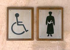 Offbeat Images -- Middle eastern man wearing dishdasha toilet sign, Nizwa Fort, Nizwa, Oman