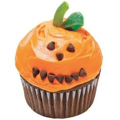 Jack O' Lantern Cupcakes with chocolate chips and green gummy candies.