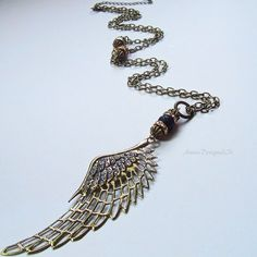 Gorgeous Angel wing necklace  Lava stone   Stunning Certified jewellery designer  Statement jewellery Long necklace Guardian angel SRAJD Angel Wing Necklace, Angel Wing Pendant, Diffuser Necklace, Bohemian Design, Gold Rhinestone, Necklace Designs, Antique Gold, Pendants, Necklaces