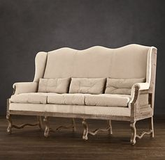 Deconstructed Wingback Settee from RH. Aka, dining sofa.