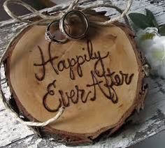 Ring bearers tree cookie slice for rent with HEARTWOOD INSPIRATIONS RUSTIC DECOR 8.00 contact Teresa McAlister for more info.