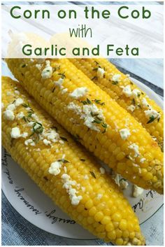 Simple and mouthwatering corn on the cob, brushed with garlicky butter and sprinkled with feta cheese crumbles. #corn