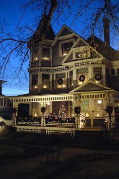 Christmas lights-I love old houses with big porches. I will own one someday. This would look good on my mini old house porch too!