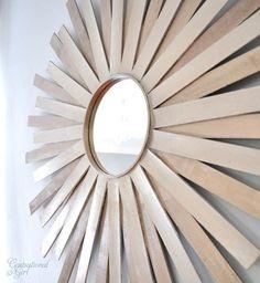 cg sunburst mirror on wall