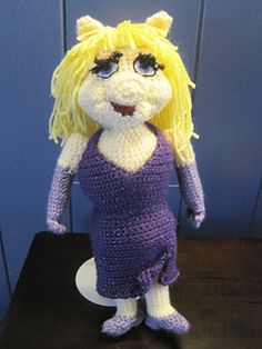 This Miss Piggy Muppet Inspired Amigurumi is approximately 14 inches tall, though gauge is not critical for this project. I have specific brands and colors of yarn I used listed in the pattern, but amigurumi is a great way to use up bits and pieces of your own stash! Message me with any questions, and Happy Hooking!