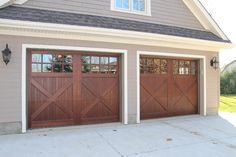 "Oxford Carriage Door Ltd. 9'-0"" x 7'-0"" Stratford Design Cedar Carriage Garage Doors. Wood garage doors. Carriage Doors. Stained using Sansin Enviro Stain '#350 Special Walnut'."