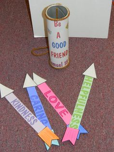 """Craft idea - Jonathan & David 'Be a good friend"""" quiver with arrows. Each arrow has a quality of a good friend. Quiver is made from an old tube, such as a pringles chips tube."""