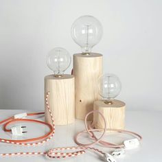 Sweet trio! Wood serves perfectly for lamp bases. Get your wiring kits at www.ilikethatlamp.com and work your magic. BTW, we have colored cotton and rayon covered wiring for a unique finish.