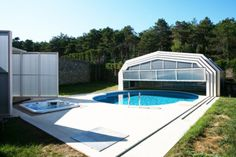 In Istanbul, Turkey this private villa needed full usage of their inground swimming pool and hot tub. Libart designed a 10.5 meter long enclosure for the backyard patio of this villa. This patio enclosure covers both the swimming pool and tub allowing the residents indoor comforts and outdoor freedom in their private comfort zones.