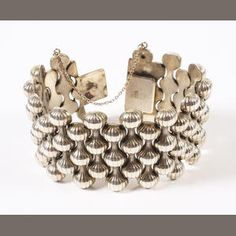 A Georg Jensen bracelet designed by Arno Malinowski Numbered 110, with stamped marks,