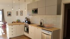 Our IKEA kitchen: Savedal cabinets, birch worktops, veddinge upper cabinets, subway tiles and edison lights