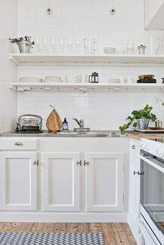 kitchen white tiles open shelves
