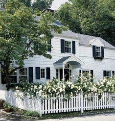 I am a sucker for a white picket fence and flowers with a beautiful home as back drop : Colonial Revival - White clapboard siding, operable shutters, and a picket fence add romance to this classic. Style At Home, Clapboard Siding, Exterior Siding, Exterior Paint, House Design Photos, White Houses, Cottage Style, White Cottage, Curb Appeal