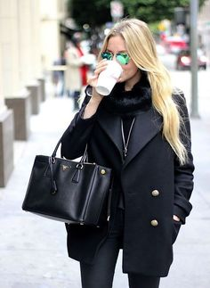 A nicely put together combination of a black pea coat and black skinny jeans will set you apart effortlessly.  Shop this look for $118:  http://lookastic.com/women/looks/sunglasses-scarf-pendant-pea-coat-tote-bag-skinny-jeans/7831  — Green Sunglasses  — Black Fur Scarf  — Silver Pendant  — Black Pea Coat  — Black Leather Tote Bag  — Black Skinny Jeans