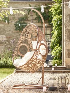 Made from durable materials that look just like light rattan, our impressive hanging chair has been intricately woven around a strong metal frame in a smooth egg shape. Woven in stunning circular patterns with a supportive base, our egg hanging chair includes a sumptuous cream armchair seat cushion and headrest. Big enough to snuggle up in with a good book and glass of wine, this statement chair is perfect for both indoors and out. This stylish woven hanging chair has been inspired by our…