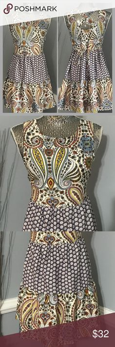 """Band Of Gypsies Multi Print Dress Size Small Cute multi print Band of Gypsies dress with paisley and floral design. Criss Cross design on back of dress with strings to tie. Perfect for spring and summer...Nice silky Polyester fabric, size small it measures about 17.25"""" across chest laying flat and is about 32.5"""" in length...offers welcome bundle to save more plus ⚡️📦📫😃💕 Band of Gypsies Dresses"""