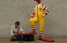 Juxtapoz Magazine - Ronald McDonald gets a Shoeshine from Banksy