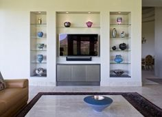 Gorgeous Floating Glass Shelves mode Phoenix Modern Living Room Decorating ideas with art display art niche bronze lacquer built in for TV built ins entertainment cabinets Living Room Cabinets, Living Room Shelves, Chic Living Room, Living Room Decor, Dining Room, Entertainment Shelves, Built In Entertainment Center, Entertainment Furniture, Tv Built In