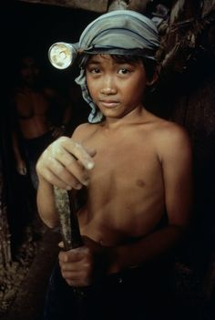 An eleven-year-old boy working in gold mine, Mindinao, Philippines, 1985  |     © Steve McCurry