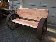 Wagon wheel bench with wood slabs