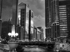 As you walk down the Riverwalk between the DuSable Bridge and the Irv Kupcinet Bridge, you'll see many historic skyscrapers including the twin towers of Marina City in Chicago, IL.