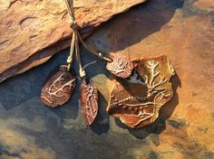 Petroglyph Cave Art Deer Pendant. Handmade ceramic bead.  This earthy handmade carved ceramic bead set is truly a gem in the hand with the unique subtle coloration and textures. Dont forget to use the ZOOM feature below each photo.  This ceramic bead set survived my rough handling during the painting process. I do this to ensure that any beads with weakness will break and not make their way to sale. I love the beauty of this form. They are each unique, earthy and rustic, yet with a natural…
