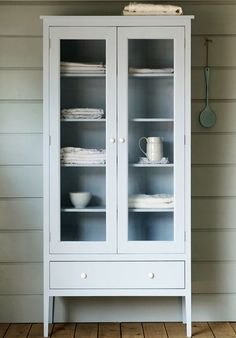 Free standing cabinet straddles Shaker and Scandinavian style.