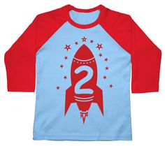 2ND BIRTHDAY ROCKET BOYS RAGLAN. This hand-printed American Apparel Raglan 3/4 sleeve t-shirt is constructed of 100% cotton. This design is available on a Light Blue/Red color and printed with red ink.