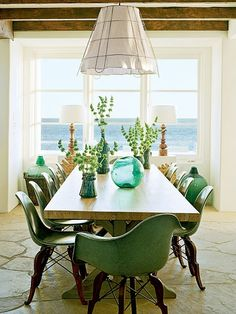 This is one of my favorite dining rooms ever! Those chairs, the colors and that gorgeous long wooden table that is decorated to perfection!