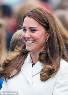 Glowing: A fresh-faced Duchess also showed off a golden tan, clearly picked up during her ...