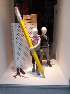 Cool explanation about the principles of design below!  Great concept too!  By making the window display props larger than the mannequin children, the eye is instantly drawn to investigate the difference in proportion (principle of design)
