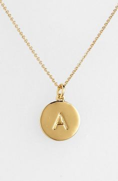 """Choose the initial that means the most to you for a shiny, gold-plated pendant suspended from a delicate rolo chain. While the initialed front salutes your sense of identity, the pendant's reverse is engraved with """"one in a million"""" to affirm your personal worth. Color(s): a- gold, b- gold, c- gold, d- gold, e- gold, f- gold, g- gold, h- gold, i- gold, j- gold, k- gold, l- gold, m- gold, n- gold, o- gold, p- gold, q- gold, r- gold, s- gold, t- gold, u- gold, v-"""