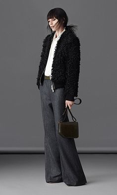 Wide-legged, high-waisted wool trousers paired with the essential cotton oxford equips the modern, dynamic woman for everyday life. A shearling jacket becomes the perfect touch of fresh and authentic luxury.