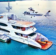 Yacht and a helicopter and mini sub ..all the toys!