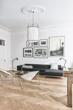 amazing scandinavian apartment with stuccoes, wooden floors and mid century modern furniture