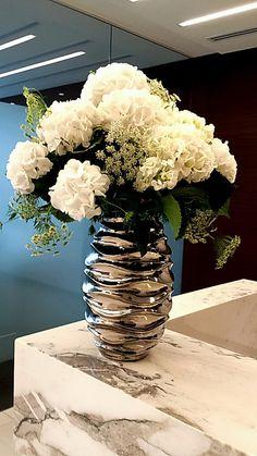 Bright white and silver hydrangea arrangement. corporate florals, silver vase, white flowers, hydrangeas.