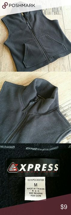 """EXPRESS THICK BLACK FLEECE VEST Black fleece vest Full zip Funnel neck when zipped up 18.5""""armpit to armpit 20.5"""" shoulder to hem Fleece is """"worn"""" price reflective No rips or stains Does need a lint roller😉 lol Smoke free home Express Jackets & Coats Vests"""