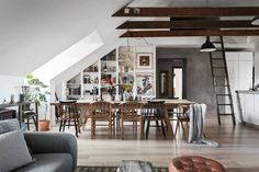 Gravity Home: Dining Space in a Scandinavian Attic Apartment