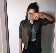 Olive green bomber jacket + black high-waisted jeans Outfit