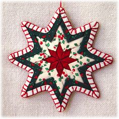 http://www.mawickecreations.com/images/products/ribbon_quilt/inside_page/rqo1starlg.jpg