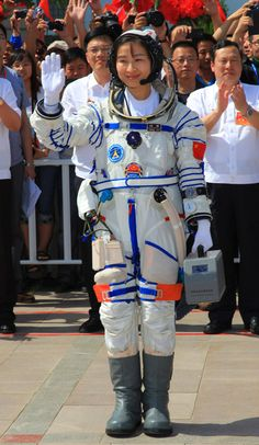 "China's first woman astronaut Maj. Liu Yang, 33, in her ""Sokol"" spacesuit headed to the launch pad and into Chinese history. Photo Credit: Xinhua"