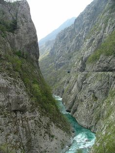 Morača River Canyon in northern Montenegro. The Morača is a fast mountain river, and has cut a canyon north of Podgorica. After merging with its largest tributary, Zeta, just north of Podgorica, the Morača enters the Zeta plain. It flows through this flat area of Montenegro until it empties into Lake Skadar. (V)