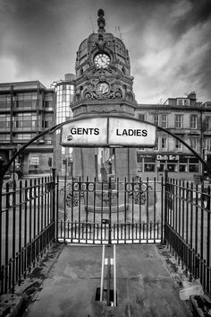 This scene can be found on Sauchiehall Street in Glasgow. It is a closed off entrance to toilets used in days gone by. The structure behind is known as the Cameron Memorial Fountain. It is a Victorian drinking fountain, comprised of Doulton terracotta resting on a granite base, was built as a tribute to Sir Charles Cameron (1843 – 1913), a much respected newspaper editor and Liberal MP.