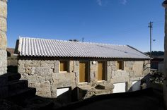 Built by Inês Cortesão in , Portugal with date Images by FG+SG – Fernando Guerra. Clara House Embraced by the village, a stone house with two floors is found at the end of an alley. The interventio. Portugal, Barn House Conversion, Old Stone Houses, Cabins And Cottages, House Extensions, Flat Roof, Kitchen On A Budget, Contemporary Architecture, Mediterranean Architecture