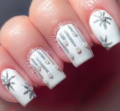 Cool Snowflake Nail Art Designs - Sparkling Silver Icicles and Snowflakes on a white background with white caviar pearl embellishments...x