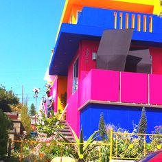 Some may say I am crazy, but YES I would like a home painted bright colors like this! (Mexican colors and architectural design.. In Santa Monica, California)